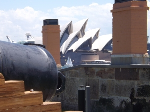 Wonderful juxtaposition of the old with the new--Ft Denison cannon in the left foreground, a sailboat in front of the Opera House, and the top of a cruise ship in the left background